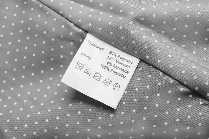 Fabric composition label on gray cloth as a background