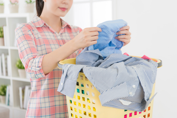 saving money at the laundromat by sorting your clothes at hoome
