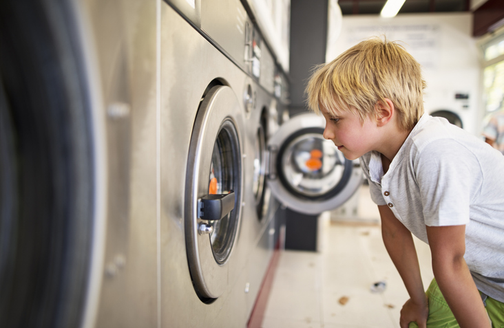 laundromat kid having fun